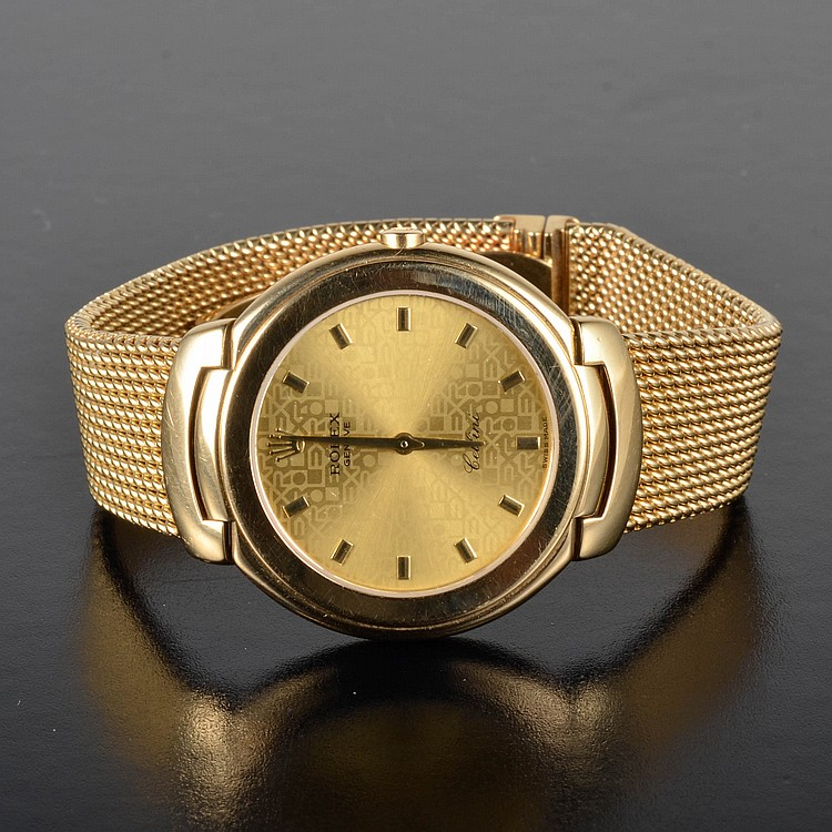 Rolex 18K gold tuxedo man's watch